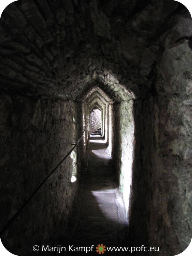 SX16121 Covered walkway towards caves under Carreg Cennen Castle.jpg